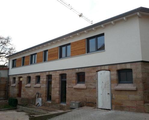 Aufstockung auf eine bestehende Scheune und Hallenneubau in Cadolzburg